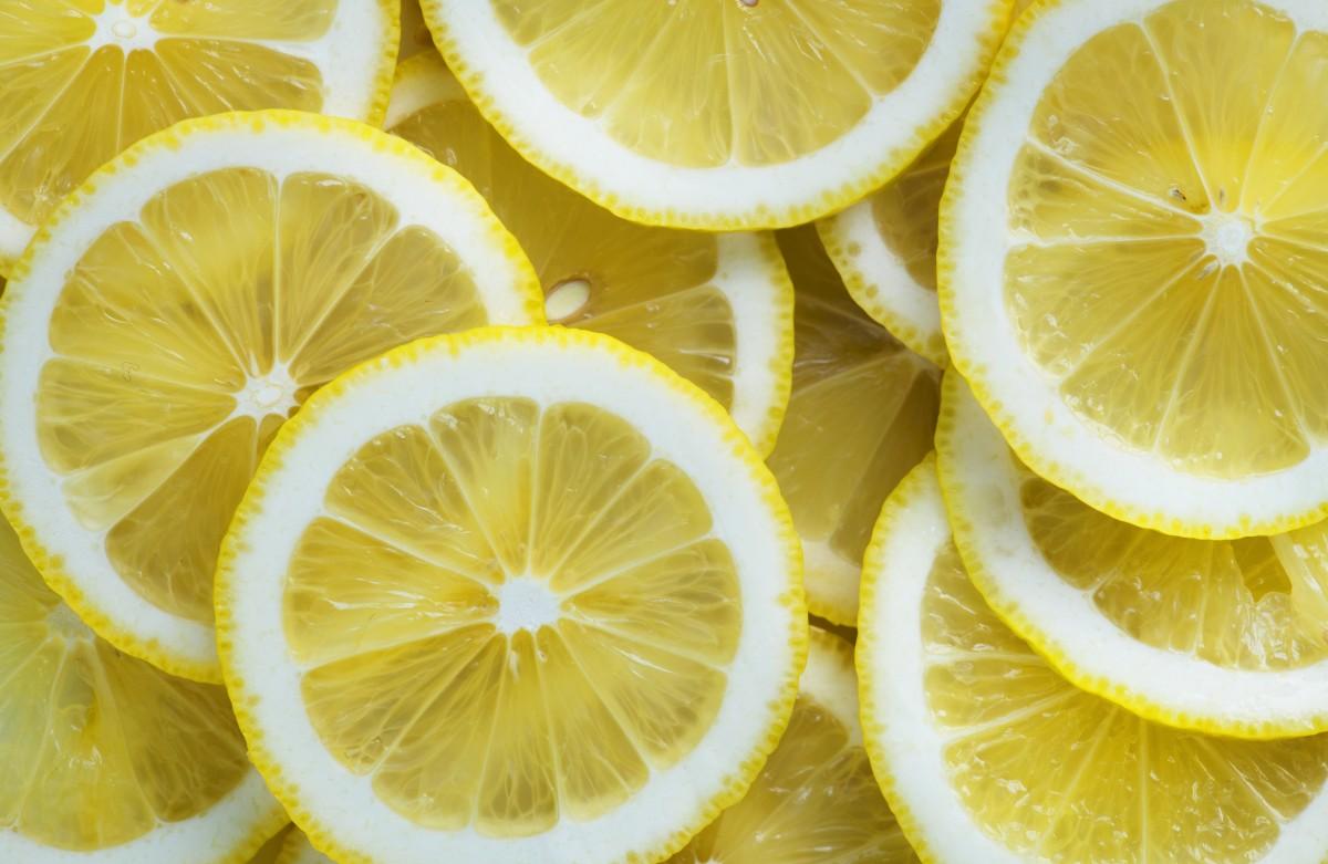 acide Contexte citrique agrumes fermer Couper dessert Désintoxication énergie aliments Frais fruit frais fraîcheur fruit moitié santé en bonne santé ingrédient jus juteux citron Tranche de citron Macro Naturel la nature nutrition biologique pièce brut rafraîchissant rafraîchissement mûr saison saisonnier tranche acide été doux goût délicieux texture tropical vibrant vitamine C Vitamines fond d'écran jaune produire acide citrique citron vert citron