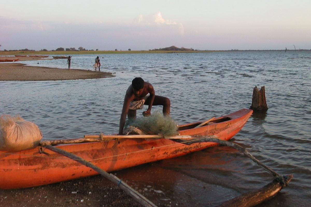 Free images man water sun sunrise sunset sunlight for Paddle boat fishing
