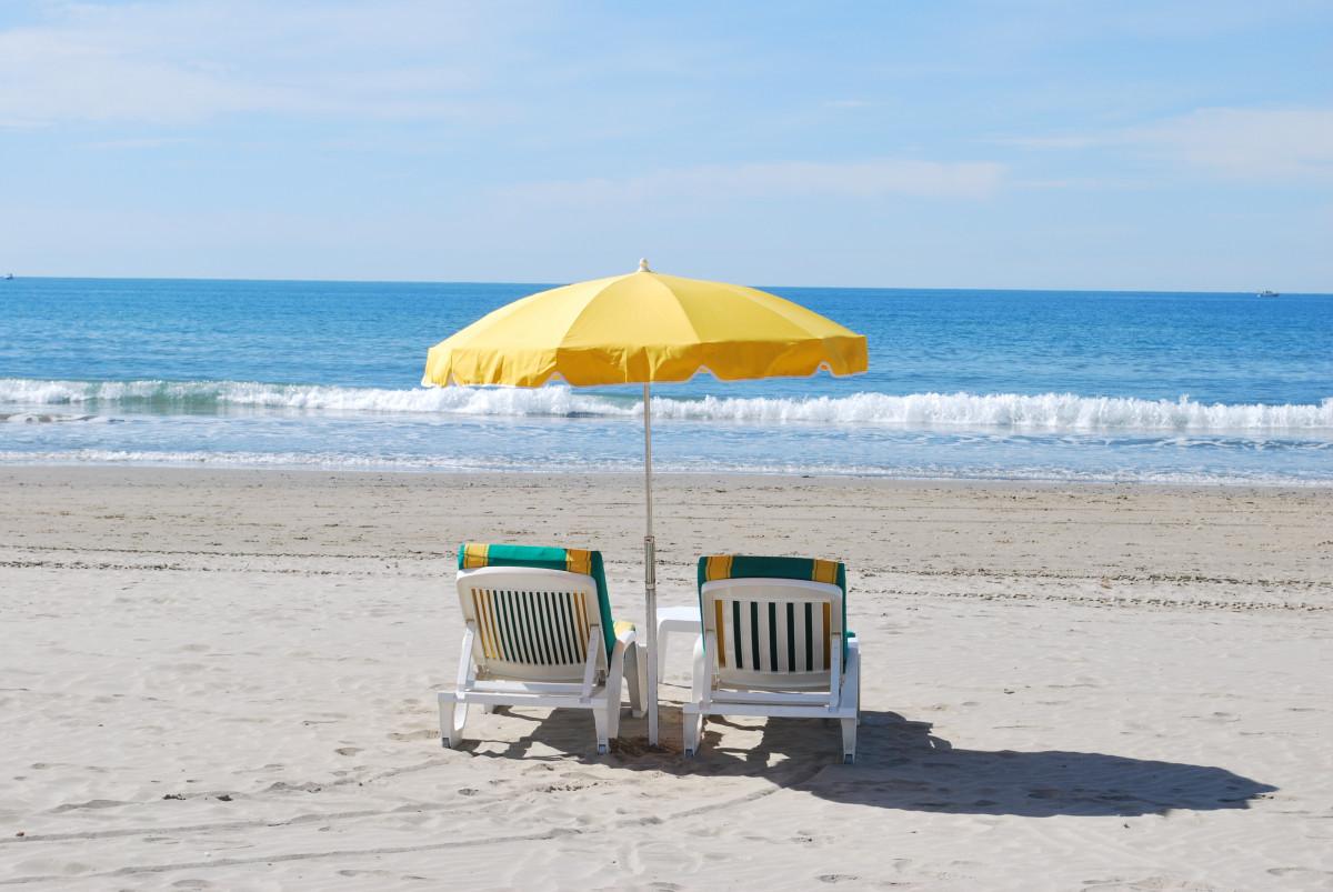 beach sea coast sand ocean shore wind vacation seaside umbrella holiday bay body of water deck chair caribbean sandy beach idleness mediterranean sea private beach