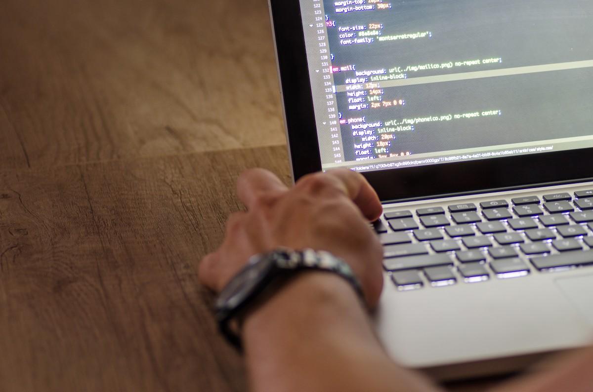 code coding computer developer development device electronics hand html laptop person program programmer programming screen work working