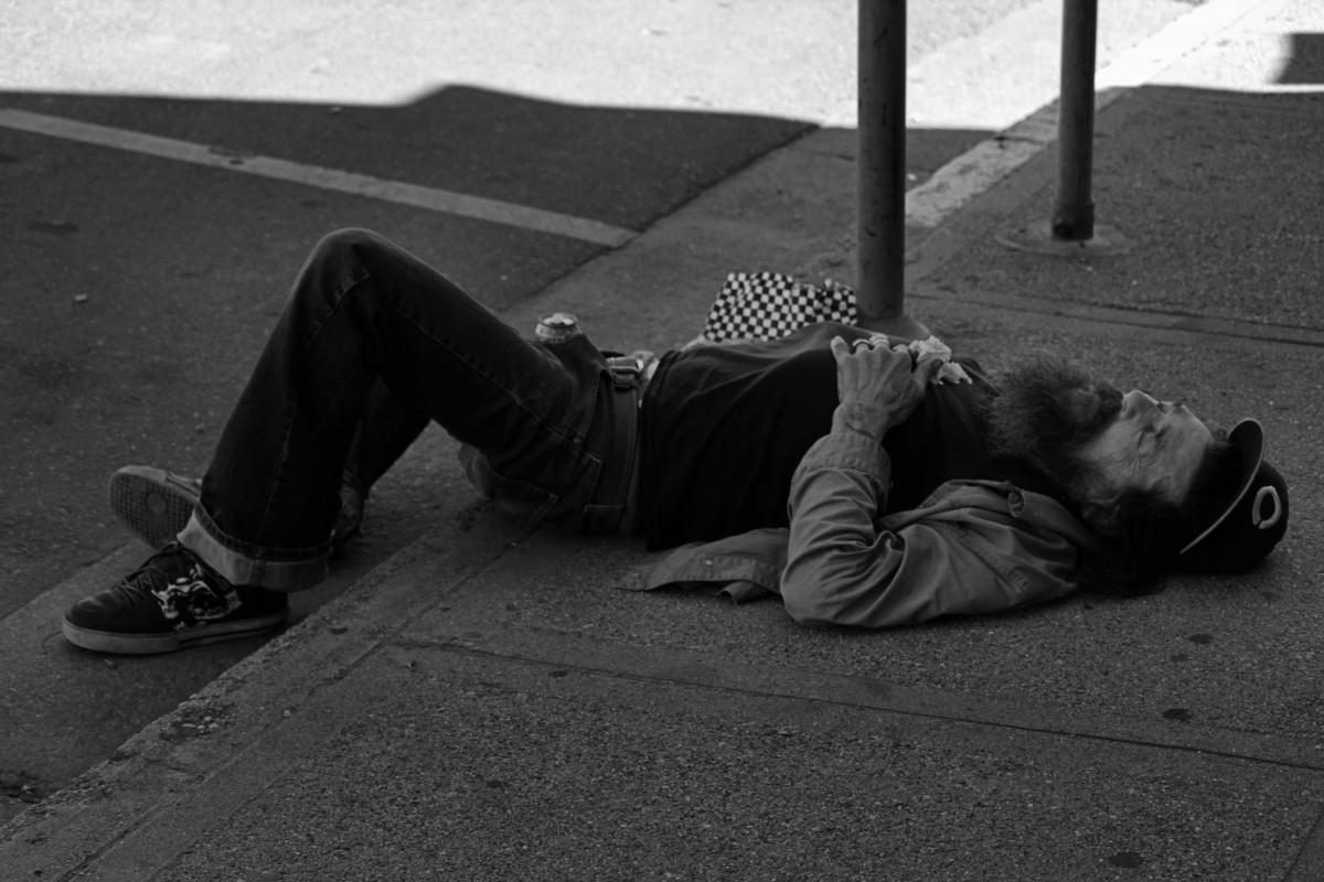 man, person, shoe, black and white, white, street, photography, sidewalk, shade, downtown, summer, color, sitting, shadow, hat, black, monochrome, beard, streetphotography, bw, blackandwhite, canada, footwear, photograph, image, mal, britishcolumbia, bc, okanagan, kelowna, passedout, shape, emotion, monochrome photography, human positions