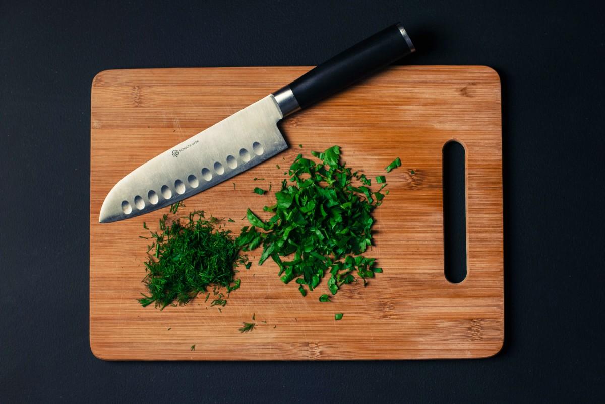 wood tool chopped food knife chopping board cutting board calligraphy herbs sliced dill