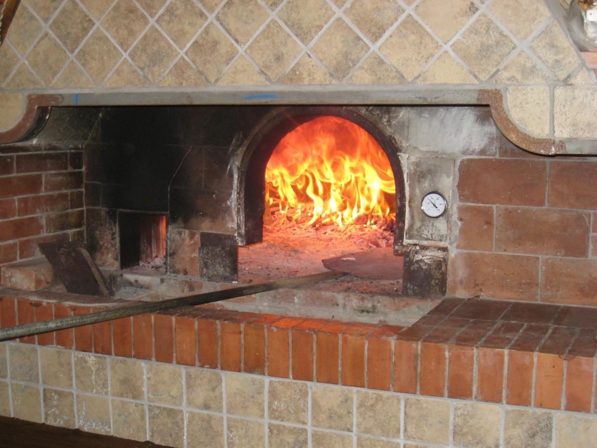 Fotos gratis restaurante r stico cocina fuego italia chimenea ladrillo pizza hornear - Cocina de fuego ...