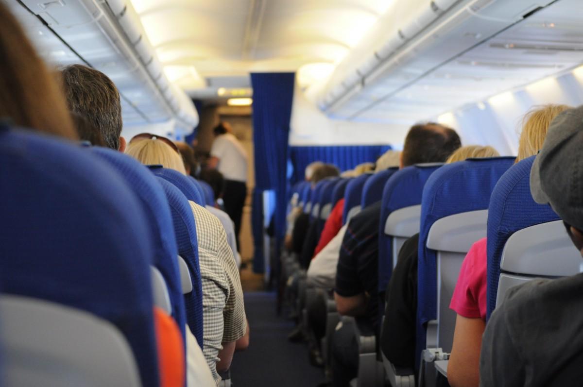 people train travel airplane transportation transport vehicle airline public transport aisle boarding seats passenger on board
