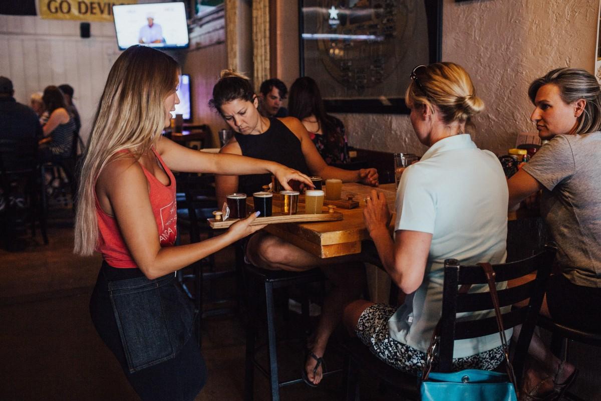 bar bartender beer drinks group indoors people restaurant server service women
