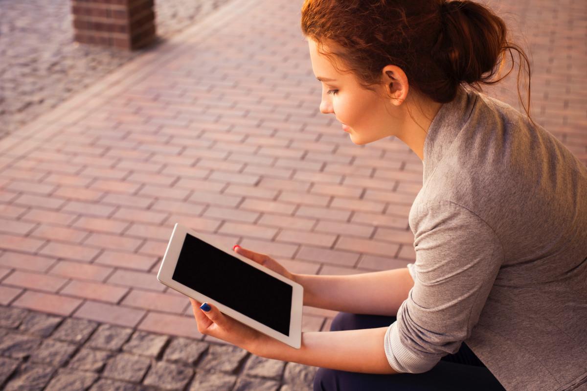 writing person girl woman ipad tablet sitting conversation sense human positions