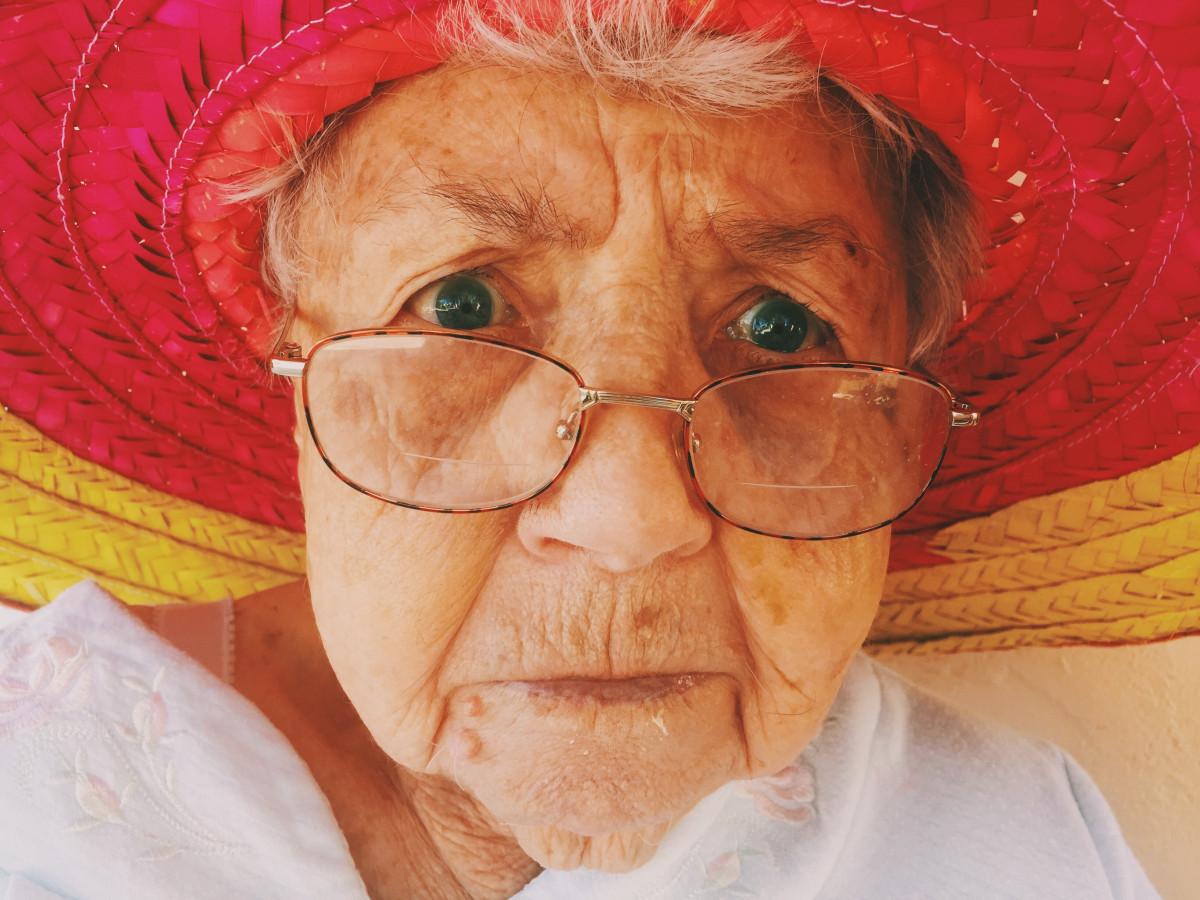 person, woman, portrait, color, hat, facial expression, grandma, grandmother, close up, face, nose, art, eye, glasses, head, skin, organ, emotion, grandparent